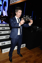 NOEL GALLAGHER winner of the Icon of The Year Award at the GQ Men of The Year Awards 2013 in association with Hugo Boss held at the Royal Opera House, London on 3rd September 2013.