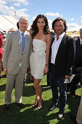 Left to right, the French Ambassador to the UK Bernard Emié, TASHA DE VASCONCELOS MOTA E CUNHA and MANUELE MALENOTTI  at the 27th annual Cartier International Polo Day featuring the 100th Coronation Cup between England and Brazil held at Guards Polo Club, Windsor Great Park, Berkshire on 24th July 2011.