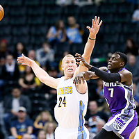 06 March 2017: Sacramento Kings guard Darren Collison (7) passes the ball over Denver Nuggets center Mason Plumlee (24) during the Denver Nuggets 108-96 victory over the Sacramento Kings, at the Pepsi Center, Denver, Colorado, USA.