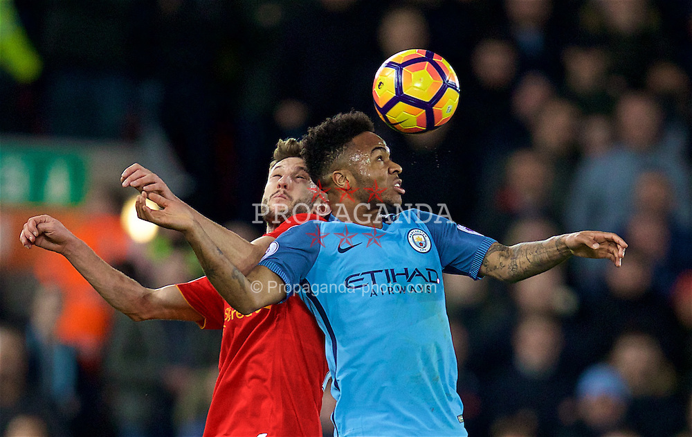 LIVERPOOL, ENGLAND - Saturday, December 31, 2016: Liverpool's Adam Lallana in action against Manchester City's Raheem Sterling during the FA Premier League match at Anfield. (Pic by David Rawcliffe/Propaganda)