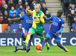 Wes Morgan of Leicester City (L) tackles Steven Naismith of Norwich City (C) - Mandatory byline: Jack Phillips/JMP - 27/02/2016 - FOOTBALL - King Power Stadium - Leicester, England - Leicester City v Norwich - Barclays Premier League