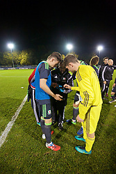 BANGOR, WALES - Tuesday, November 15, 2016: Wales' Wales and goalkeeper Fergal Hale-Brown discuss the final standings after the 6-2 victory over Luxembourg during the UEFA European Under-19 Championship Qualifying Round Group 6 match at the Nantporth Stadium. (Pic by David Rawcliffe/Propaganda)