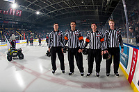 KELOWNA, CANADA - JANUARY 4:  Referee Steve Papp stands at centre ice with ice officials for his 600th game at the Kelowna Rockets against the Prince George Cougars on January 4, 2019 at Prospera Place in Kelowna, British Columbia, Canada.  (Photo by Marissa Baecker/Shoot the Breeze)