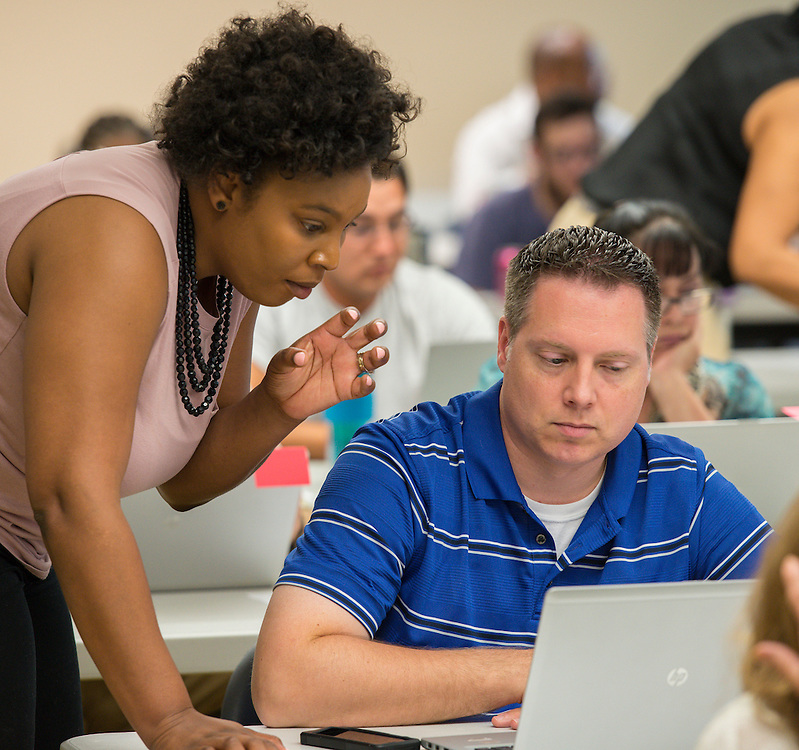 Teachers attend PowerUp Hub training at Bellaire High School, August 19, 2014.