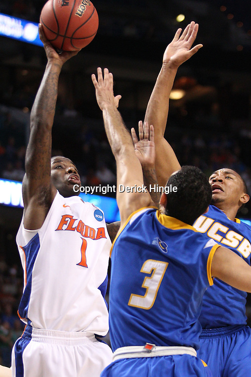 Mar 17, 2011; Tampa, FL, USA; Florida Gators guard Kenny Boynton (1) shoots over UC Santa Barbara Gauchos defenders guard Jordan Weiner (3) and guard/forward Orlando Johnson (33) during first half of the second round of the 2011 NCAA men's basketball tournament at the St. Pete Times Forum.  Mandatory Credit: Derick E. Hingle