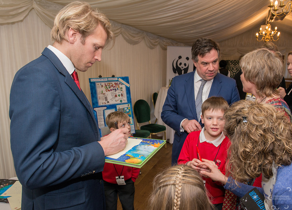 Primary School winners get an autograph from Andrew Triggs Hodge and Panda during the WWF UK Earth Hour 10th Anniversary Parliamentary Reception, Terrace Pavilion, Palace of Westminster. 28th Feb. 2017