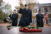 Air Force R.O.T.C. Cadet Fourth Class, Taylor Shipley, 18, salutes after placing a rose in memory of U.S. POWs and MIAs while Cadet Third Class Brent Yocum, 19, and Cadet Third Class Sharon Curry, 19, stand by in front of the new Baker Center on Veteran's Day in Athens, Ohio on Sunday, Nov. 11, 2007. (Ohio University /CHAD BARTLETT)