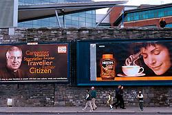 IRELAND DUBLIN MAR00 - A Nescafe billboard hangs alongside a campaign poster for Travellers' Rights... jre/Photo by Jiri Rezac. . © Jiri Rezac 2000. . Tel:   +44 (0) 7050 110 417. Email: info@jirirezac.com. Web:   www.jirirezac.com