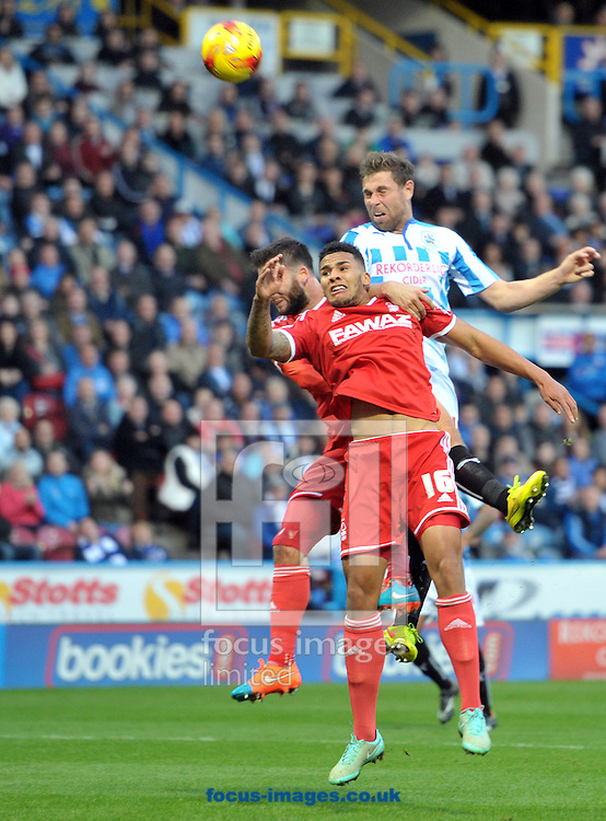 Grant Holt of Huddersfield Town heads for goal against Nottingham Forest during the Sky Bet Championship match at the John Smiths Stadium, Huddersfield<br /> Picture by Graham Crowther/Focus Images Ltd +44 7763 140036<br /> 01/11/2014