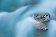 Water flows around rocks in North Fork Cascade River, Mount Baker-Snoqualmie National Forest, Washington.