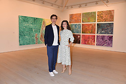 Artist Sassan Behnam-Bakhtiar and his wife Maria at a preview of an exhibition of art by Sassan Behnam-Bakhtiar entitled 'Oneness Wholeness' held at the Saatchi Gallery, Duke of York's HQ, King's Rd, London, England. 14 May 2018.