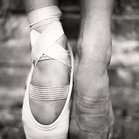 Close up of young girls ballet shoe and bare foot