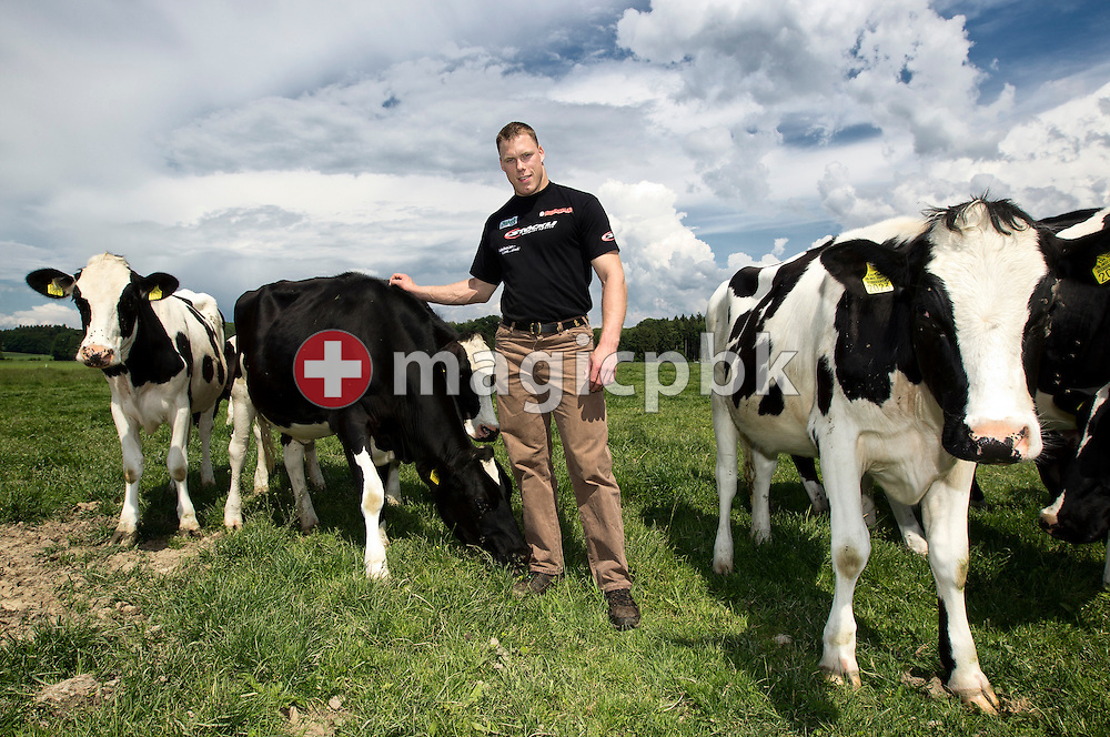 Swiss wrestling star Matthias SEMPACH of Switzerland is pictured with cattle on the pasture of the Bruegger-Hof in Willadingen, Switzerland, Friday, May 20, 2011. (Photo by Patrick B. Kraemer / MAGICPBK)