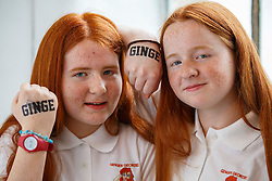© Licensed to London News Pictures. 17/09/2016. London, UK. Twins Emily Doughty and Libby Doughty pose with tattoos as hundreds of redheads attend Redhead Day UK event in Angel, London on Saturday, 17 September 2016. Natural redhead visitors get chance to celebrate their ginger genes and shop specialised products, see ginger related exhibitions and live performances. Photo credit: Tolga Akmen/LNP