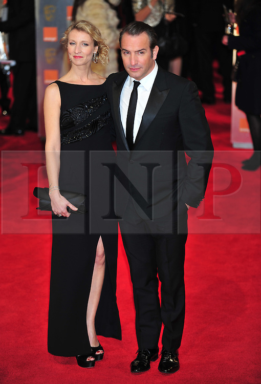 © Licensed to London News Pictures. 12/02/2012. London, England. Jean Dujardin and Alexandra Lamy arrives for the Orange British Academy Film Awards at The Royal Opera House on February 12, 2012 in London, England. Photo credit : ALAN ROXBOROUGH/LNP