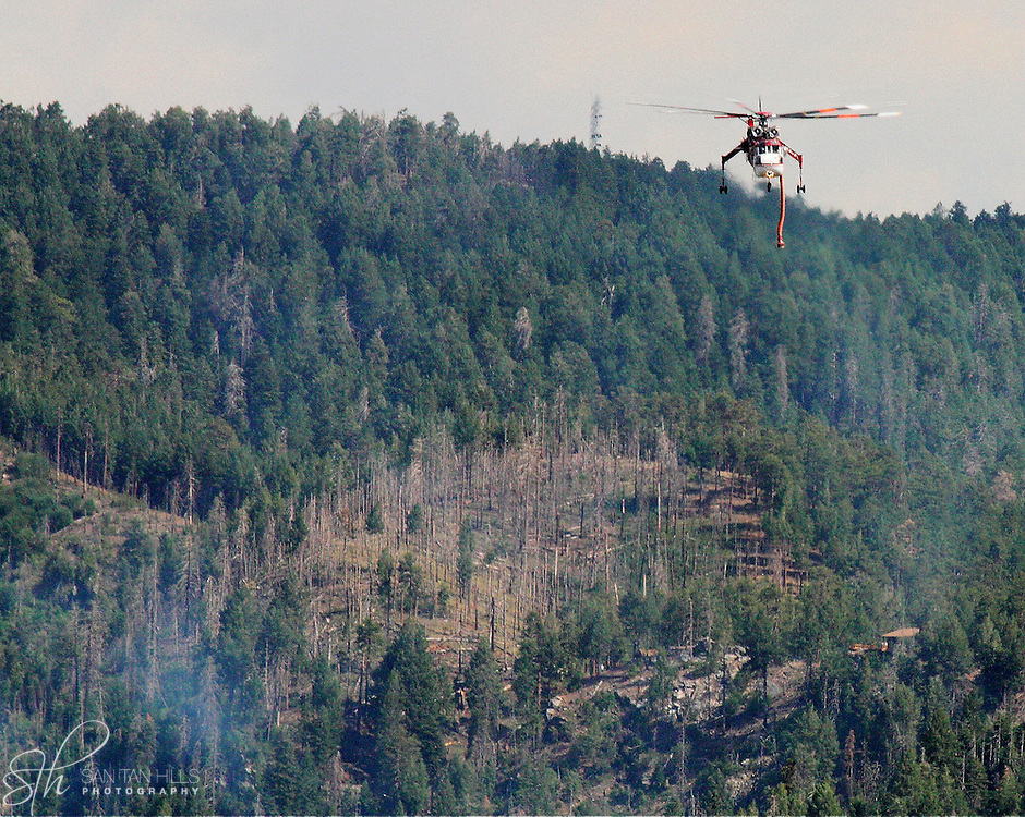 Helicopter fighting fire on the north side of Mt. Lemmon