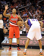Nov. 21, 2012; Phoenix, AZ, USA; Portland Trail Blazers guard Damian Lillard (0) calls out a play on the court during the game against the Phoenix Suns guard Sebastian Telfair (31) in the first half at US Airways Center. The Suns defeated the Trail Blazers 114-87. Mandatory Credit: Jennifer Stewart-US PRESSWIRE