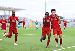 NAPLES, ITALY - Wednesday, October 3, 2018: Liverpool's Bobby Adekanye (C) celebrates scoring the first goal with team-mates Rafael Camacho (L) and Curtis Jones (R) during the UEFA Youth League Group C match between S.S.C. Napoli and Liverpool FC at Stadio Comunale di Frattamaggiore. (Pic by David Rawcliffe/Propaganda)