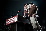 "President Mikhail Saakashvili speaking to is supporters (with an unknown child) in the Sport Palace in Tbilisi, Georgia on 04 January, 2008 on the day before the Presidential Elections. Saakashvili was elected president in January 2004. OSCE observers described the vote as a ""welcome contrast"" to a rigged parliamentary poll the previous November. Mr Saakashvili had led the ''Rose Revolution'' protests which followed that election, forcing his predecessor as president, Eduard Shevardnadze, to resign. Soon after that, Mr Saakashvili consolidated his position when his National Movement-Democratic Front won parliamentary elections. It holds the majority of seats and opposition representation is extremely weak. However, after last months protests of the opposition, that were violently stopped by the police, several parties expect that there will be again demonstrations organized by the (pro Russian) opposition if Saakashvili will win the elections held on January 5. **FRANCE NEWSPAPERS OUT UNTIL JANUARY 6, 2008**"