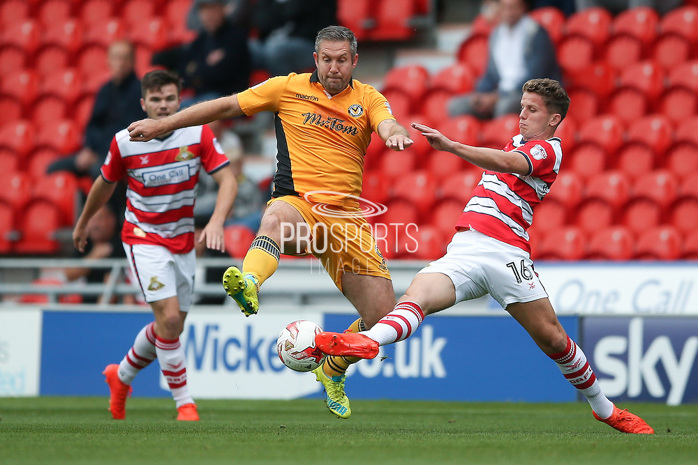 Doncaster Rovers midfielder, on loan from Chelsea, Jordan Houghton (16)  tackles Newport County  forward Jonathan Parkin (9)  during the EFL Sky Bet League 2 match between Doncaster Rovers and Newport County at the Keepmoat Stadium, Doncaster, England on 17 September 2016. Photo by Simon Davies.