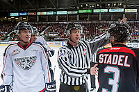 KELOWNA, CANADA - OCTOBER 21: Carson Focht #17 of the Tri-City Americans trash talks Riley Stadel #3 of the Kelowna Rockets as linesman Cody Wanner intervenes on October 21, 2016 at Prospera Place in Kelowna, British Columbia, Canada.  (Photo by Marissa Baecker/Shoot the Breeze)  *** Local Caption ***