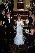 A bride and groom enter their wedding reception in the Sutter Club, Sacramento, California.