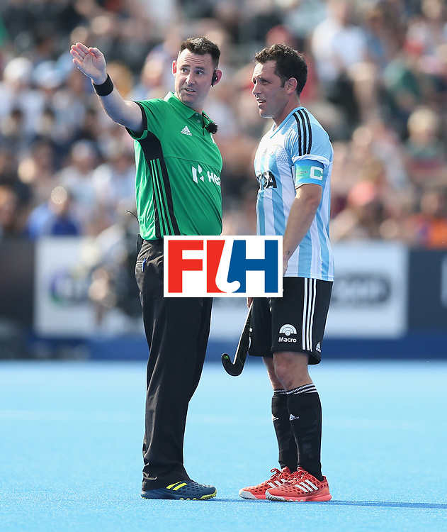 LONDON, ENGLAND - JUNE 18:  Pedro Ibarra of Argentina talks to a match official during the Hero Hockey World League Semi-Final match between England and Argentina at Lee Valley Hockey and Tennis Centre on June 18, 2017 in London, England.  (Photo by Alex Morton/Getty Images)