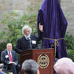 Photos by Tom Kelly IV<br /> Fred Morsell, reading as Frederick Douglass during the dedication of the Frederick Douglass statue at West Chester University, Tuesday afternoon October 1, 2013 with the statue still covered behind him.