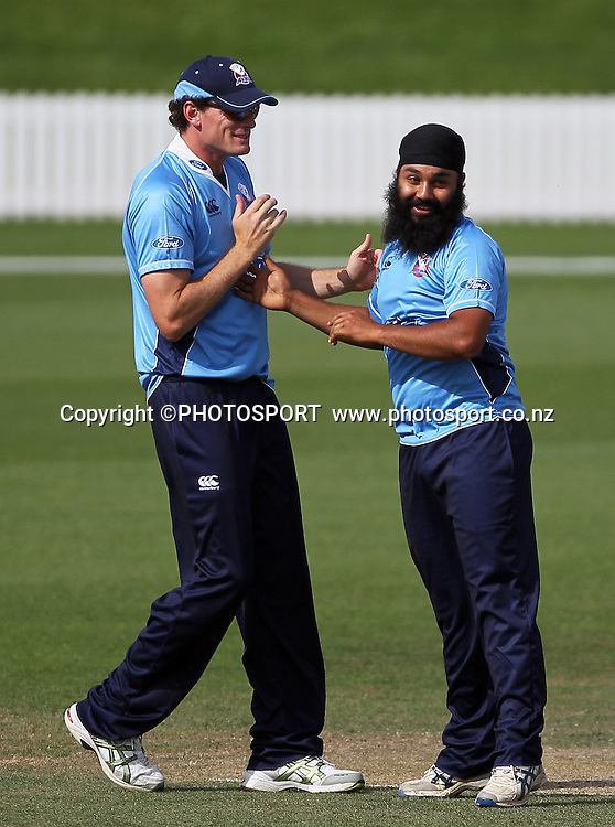 Bhupinder Singh is congratulated by Auckland team mate Kyle Mills after his wicket of James Franklin. Auckland Aces v Wellington Firebirds, Ford Trophy one day game held at Burt Sutcliffe Oval, Lincoln, Friday 25 November 2011. Photo : Joseph Johnson / photosport.co.nz
