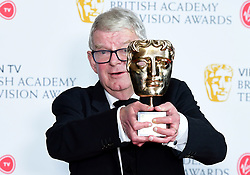 John Motson with his Bafta special award in the press room at the Virgin TV British Academy Television Awards 2018 held at the Royal Festival Hall, Southbank Centre, London.