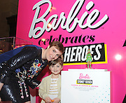 "Lena Dunham is in awe of Sydney ""Mayhem"" Keiser's one-of-a-kind Barbie displayed at the Variety Power of Women event, Friday, April 24, 2015, in New York, where Lena was honored with a Lifetime Achievement award.  Sydney, 5, the founder of Fashion by Mayhem, was honored as a Barbie Shero at the event which celebrates powerful women.  (Photo by Diane Bondareff/Invision for Barbie/AP Images)"