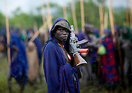 Surma man with a Kalashnikov, Omo valley, Ethiopia.<br />
