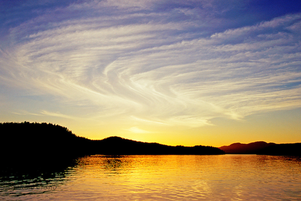 CANADA, Princess Royal Island (BC).Sunset with S-shaped cloud formation