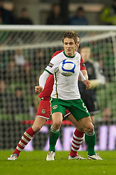 DUBLIN, IRELAND - Tuesday, February 8, 2011: Wales' Danny Collins and the Republic of Ireland's Kevin Doyle during the opening Carling Nations Cup match at the Aviva Stadium (Lansdowne Road). (Photo by David Rawcliffe/Propaganda)
