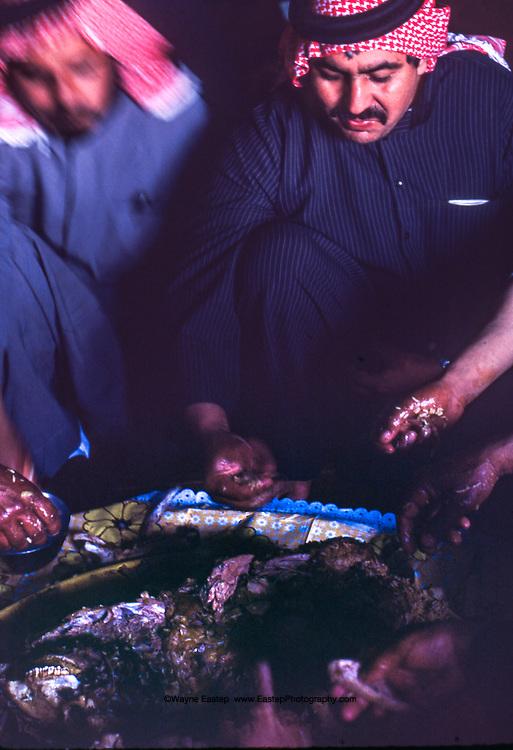 Al Amrah clan members, eating their main meal of the day, Saudi Arabia