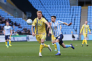 Millwall FC defender Byron Webster (17)  battles with Coventry City midfielder Ruben Lameiras (8)  during the Sky Bet League 1 match between Coventry City and Millwall at the Ricoh Arena, Coventry, England on 16 April 2016. Photo by Simon Davies.