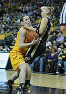 January 28, 2012: Iowa Hawkeyes guard Samantha Logic (22) drives into Purdue Boilermakers guard Brittany Rayburn (5) during the NCAA women's basketball game between the Purdue Boilermakers and the Iowa Hawkeyes at Carver-Hawkeye Arena in Iowa City, Iowa on Saturday, January 28, 2012.