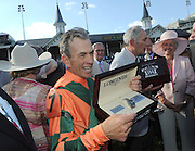 Jockey Kerwin Clark shows off his new Longines Conquest Classic after he rode Lovely Maria to win the Longines Kentucky Oaks, Friday, May 1, 2015, in Louisville, Ky. Longines, the Swiss watch manufacturer known for its luxury timepieces, is the Official Watch and Timekeeper of the 141st annual Kentucky Derby. (Photo by Diane Bondareff/Invision for Longines/AP Images)