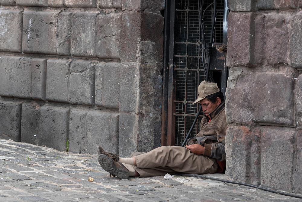Man sitting in a doorway in Saint Francis Square, Quito, Ecuador.
