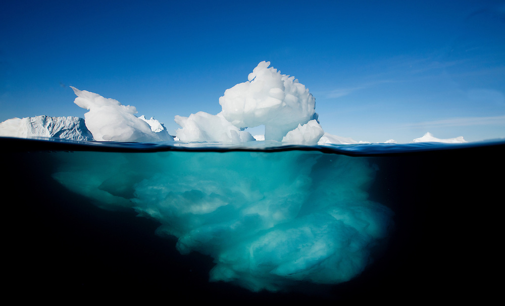 Greenland, Ilulissat, Underwater image of icebergs floating near face of Jakobshavn Isfjord on summer afternoon