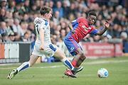 Bernard Mensah (Aldershot Town) turns away from Connor Jennings (Tranmere Rovers) to clear the ball from danger during the Vanarama National League second leg play off match between Tranmere Rovers and Aldershot Town at Prenton Park, Birkenhead, England on 6 May 2017. Photo by Mark P Doherty.