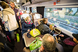 © Licensed to London News Pictures. 27/12/2013. Swansea, London, UK. Passengers are forced to stand on a crowded Swansea-Paddington rail service due to disruption to the service resulting from the adverse weather conditions over the Christmas break. Photo credit : Richard Isaac/LNP