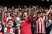 Fans celebrate the goal of John Lundstram of Sheffield United during the Premier League match between Sheffield United and Crystal Palace at Bramall Lane, Sheffield, England on 18 August 2019.