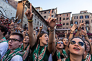 Italy, Siena, the Palio: the day before the Palio young supporters of the different contrada sing in a choir the contrada's songs to each other