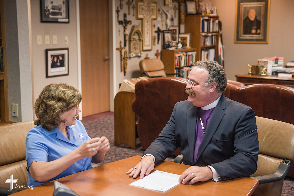 LCMS President Rev. Dr. Matthew C. Harrison chats with Patti Garibay, national executive director of American Heritage Girls, before the signing of a Memorandum of Understanding on Wednesday, May 14, 2014, at the International Center of The Lutheran Church--Missouri Synod in Kirkwood, Mo.  LCMS Communications/Erik M. Lunsford