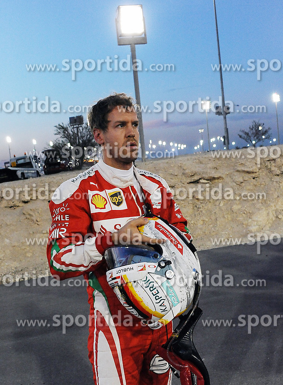 03.04.2016, International Circuit, Sakhir, BHR, FIA, Formel 1, Grand Prix von Bahrain, Rennen, im Bild Sebastian Vettel (GER) Ferrari SF16-H retires from the race on the parade lap. // during Race for the FIA Formula One Grand Prix of Bahrain at the International Circuit in Sakhir, Bahrain on 2016/04/03. EXPA Pictures &copy; 2016, PhotoCredit: EXPA/ Sutton Images/ Rubio/<br /> <br /> *****ATTENTION - for AUT, SLO, CRO, SRB, BIH, MAZ only*****