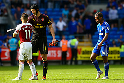 Lucas Torreira of Arsenal shakes hands with Petr Cech of Arsenal after the final whistle of the match whilst Bobby Reid of Cardiff City heads for the tunnel - Mandatory by-line: Ryan Hiscott/JMP - 02/09/2018 -  FOOTBALL - Cardiff City Stadium - Cardiff, Wales -  Cardiff City v Arsenal - Premier League