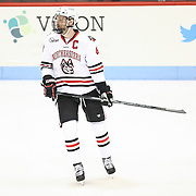 Adam Reid #8 of the Northeastern Huskies is seen on the ice prior to the game against the Minnesota Gophers at Matthews Arena on November 29, 2014 in Boston, Massachusetts. (Photo by Elan Kawesch)