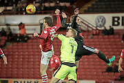 Adam Davies (Barnsley) fails to get to the ball, caught between the Nottingham Forest attacker and Sam Winnall (Barnsley) during the EFL Sky Bet Championship match between Barnsley and Nottingham Forest at Oakwell, Barnsley, England on 25 November 2016. Photo by Mark P Doherty.