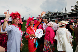 Participants walk the turf track in the annual Kentucky Oaks Survivor's Parade ,Friday, May 04, 2018 at the Churchill Downs  in Louisville. The parade celebrates those that have survived cancer as well as a memorial for those who it has taken.